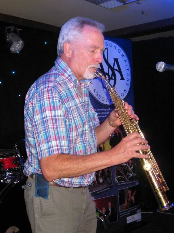 Author Ned Wolf playing saxaphone